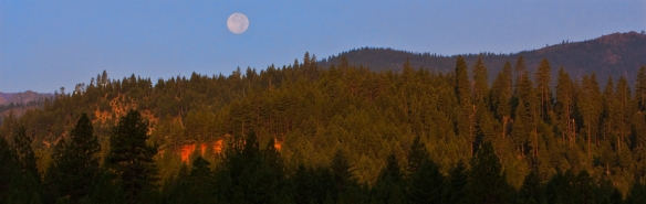 The setting moon over Califorina's Trinity Alps