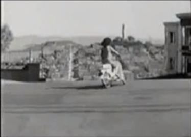 A Honda Cub going down Lombard Street